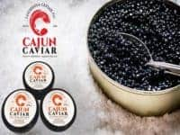 Jar with black cajun caviar and a spoon of salt.