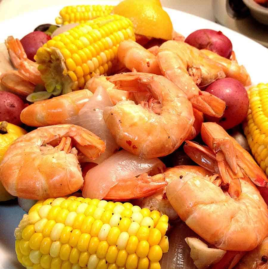 A classic shrimp boil with wild caught gulf shrimp fresh core and sweet red potatoes.